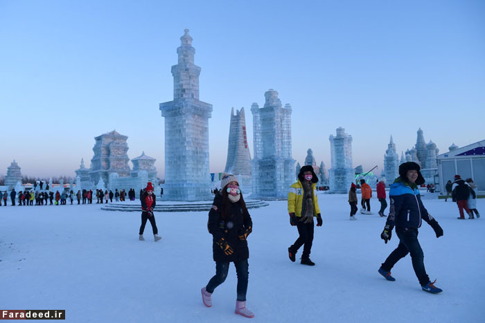 People visit the China Ice and Snow World on the eve of the opening ceremony of the Harbin International Ice and Snow Festival in Harbin, northeast China's Heilongjiang province on January 4, 2016. Over one million visitors are expected to attend the spectacular Harbin Ice Festival, where buildings of ice are bathed in ethereal lights and international ice sculptors compete for honours. AFP PHOTO / WANG ZHAOWANG ZHAO/AFP/Getty Images ORG XMIT: